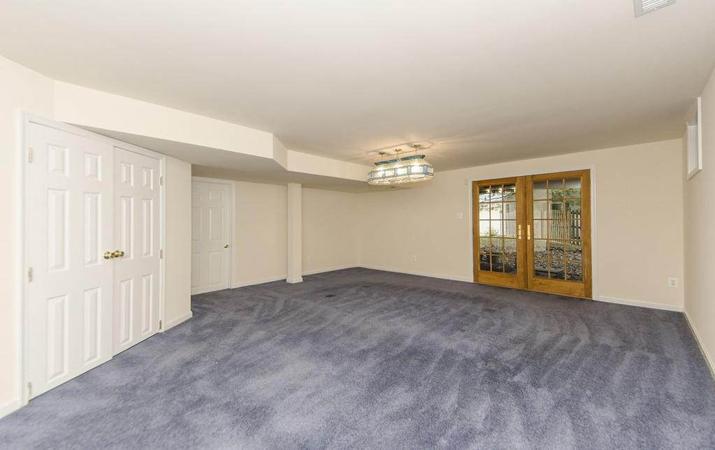 will appreciate the 3 additional bedrooms on this level and one full bath. All bedrooms are carpeted and have ceiling fans.