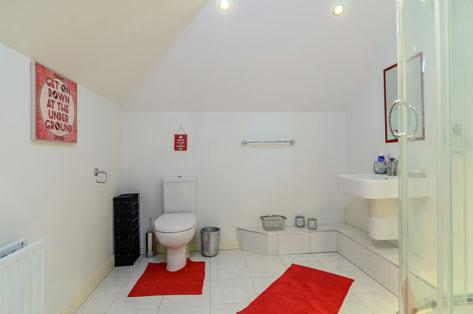 "cubicle, tiled floor, low voltage spotlights, extractor fan. BEDROOM (4): 19' 10"" x 16' 0"" (6.05m x 4."