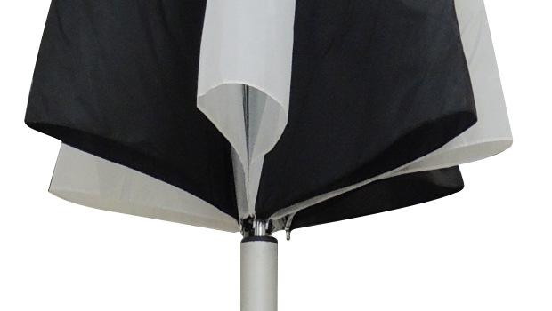 As the umbrella is released, it will open (reference image shown).
