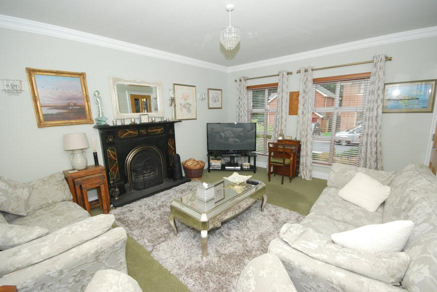 The Property Comprises: ENTRANCE HALL: Ceramic Tiled Floor, upvc panelled front door and double glazed side panels, walk-in cloak/storage cupboard.