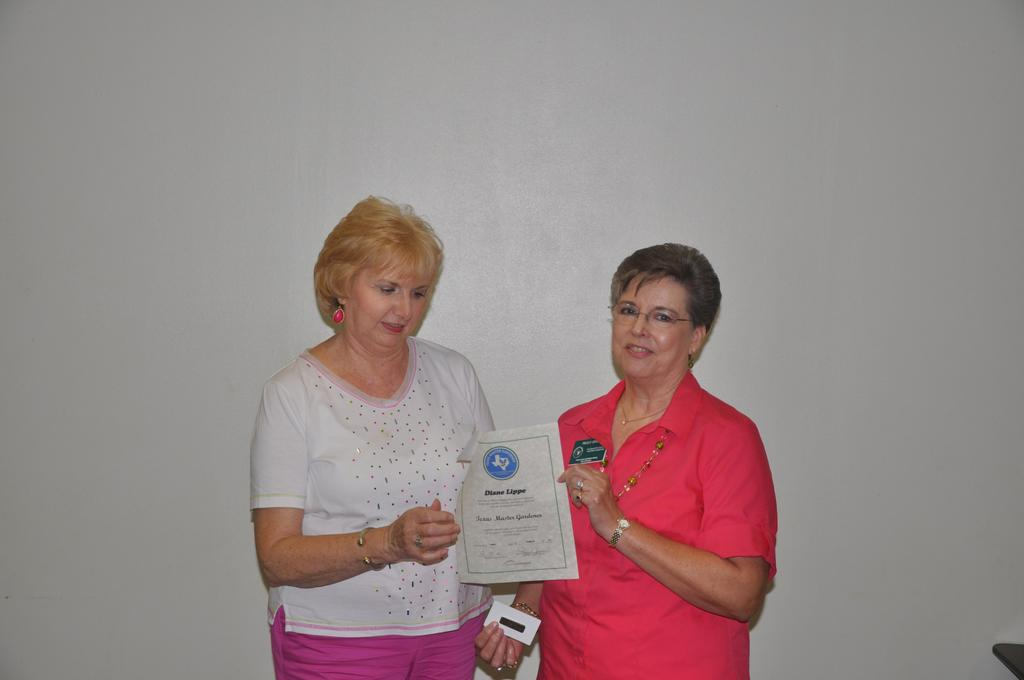 NEWLY CERTIFIED MASTER GARDENER Diane Lippe was recognized as being a newly certified Master Gardener; she received her certificate, name badge, and membership card from President Peggy Jones at the