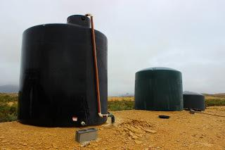 greenhouse, pumped into large water storage tanks and