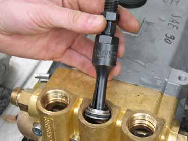 Loosen the lockscrews of the pressure valves.