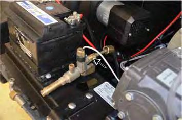 Disconnect the high-pressure outlet to the booster heater.