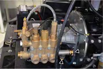 Disconnect the high-pressure outlet and return line from the pump head.