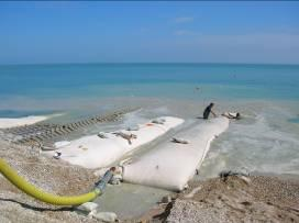 The Construction was started in April 2008 (Figure 23) Figure 22: Geotextile Bag Installation at Pahang Figure 23: Geotextile Tube Installation (Italy) SUMMARY AND CONCLUSIONS: 1.