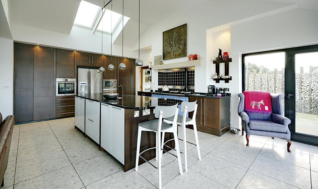 KITCHEN: Contemporary kitchen with excellent range of high and low level units, granite work surfaces.