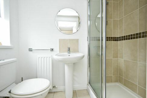 Door to: ENSUITE SHOWER ROOM: White suite comprising low flush wc,