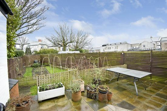 REAR GARDEN: Enclosed rear garden with lawn and