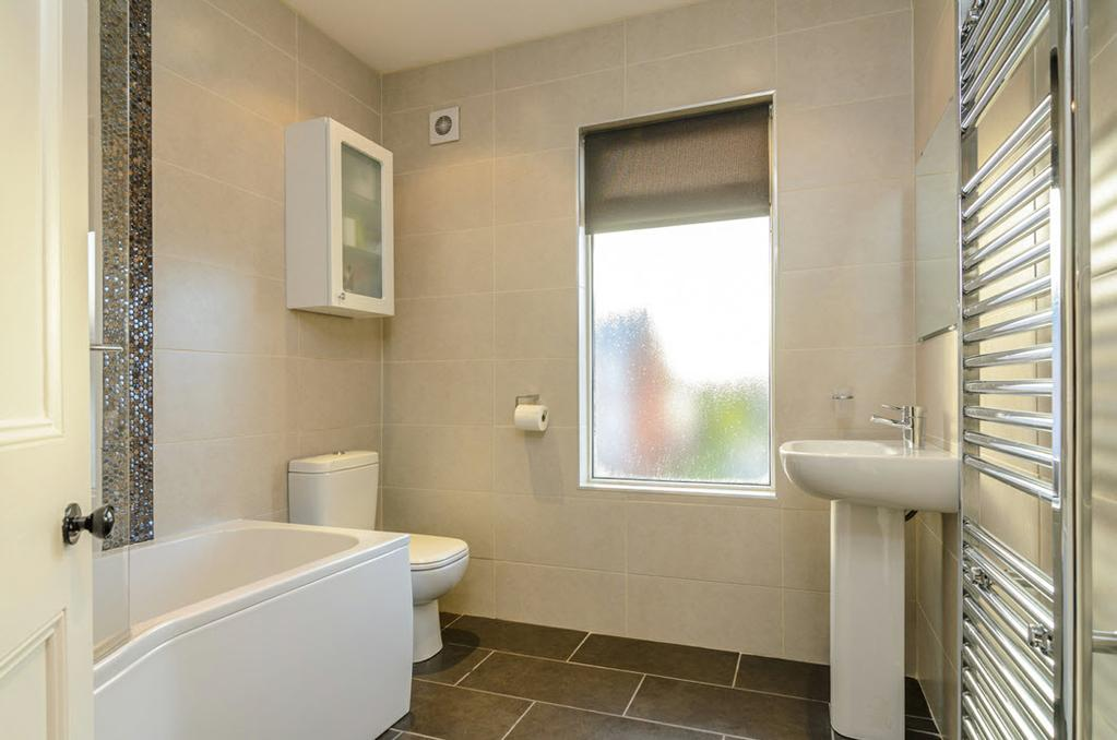 panelled bath with mixer taps & Mira built-in power