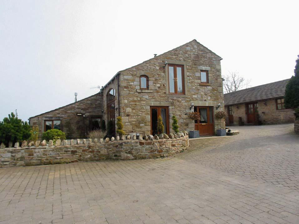 Hollins Barn Ightenhill Park Lane, Burnley. BB12 0RW Price: 550,000 Superb barn conversion with amazing views out to Pendle and as far as Noyna Top.