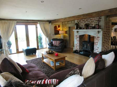 Fully tiled floor, double panelled radiator and exposed beams. Feature fireplace.