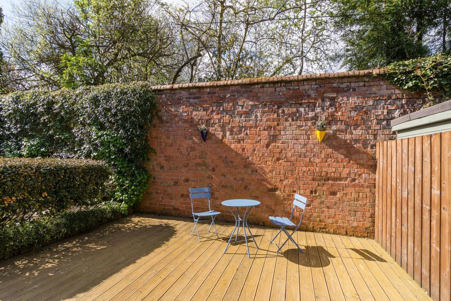 Landscaped south facing rear gardens incorporating pebbled areas with inset beds,