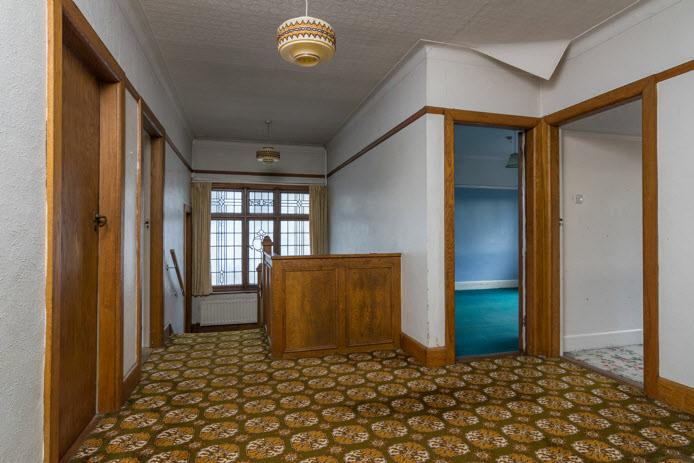 SPACIOUS LANDING: Feature leaded glass window, access to large roofspace