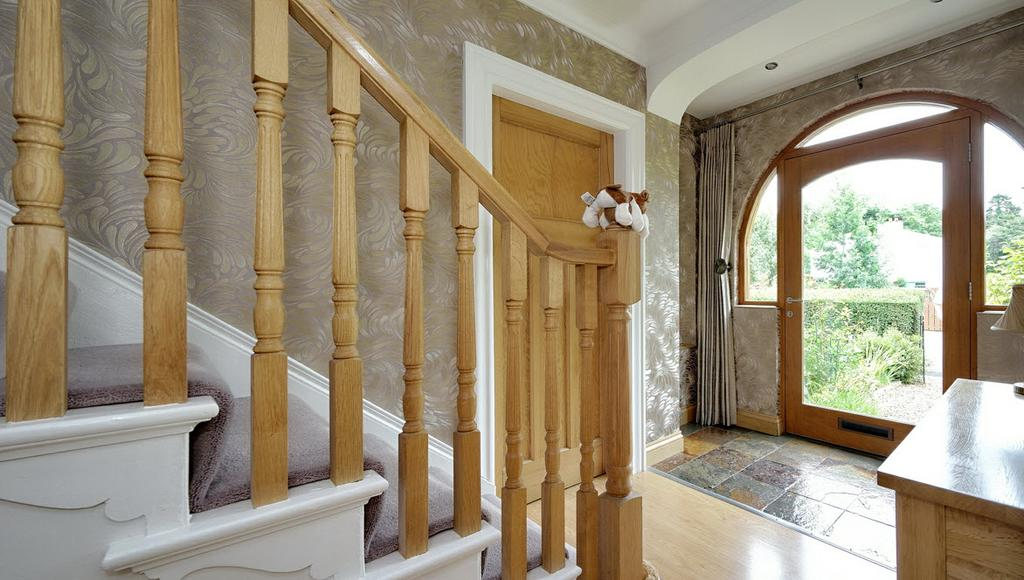 to... ENTRANCE HALL: With under stairs storage and