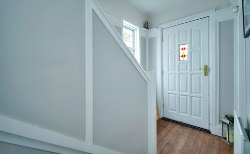The Property Comprises: ENTRANCE PORCH: Hardwood front door.
