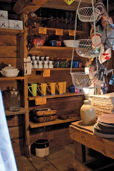 Delight in the displays on shelves built into the old rowboat found on the banks of Thessalon River and admire the many items displayed atop the old wagon bought at an auction.
