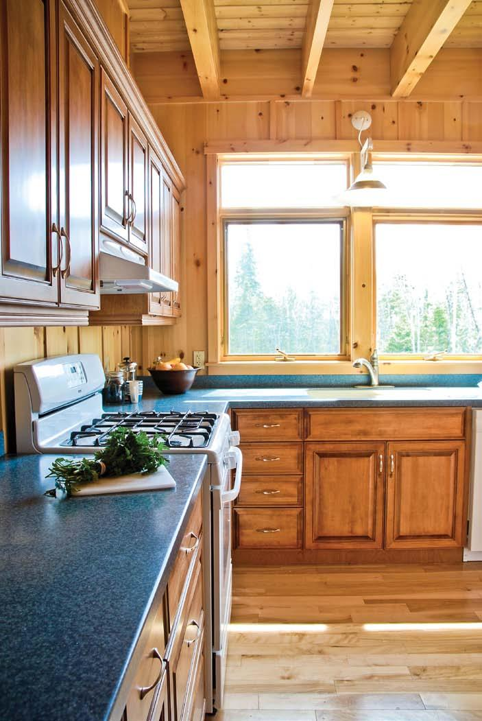 home & builder LEFT: The L-shaped kitchen provides an efficient workspace for meal preparation.