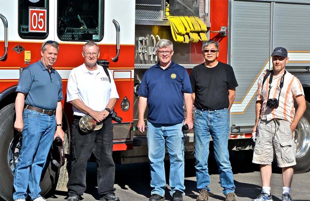 Earlier in the summer, several members joined John Bowerman (left) and Mark McDonald (centre) in their home province to tour Calgary area stations. Pictured here with Calgary P.