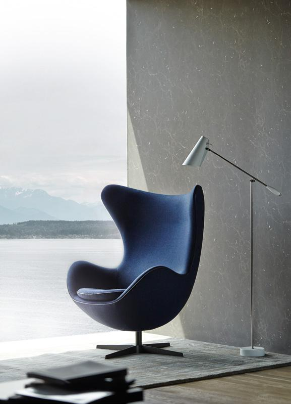 LAMINATE OSSIDI LIMESTONE DXN 5328D Arne Jacobsen limited-edition egg chair, and Birdy floor lamp, both from Danish Design.